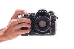 Nikon D200 DSLR Camera. Hand Holding a Nikon D200 Pro-Level DSLR Camera Stock Image
