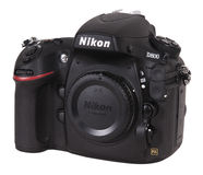 Nikon D800 SLR Digital Camera Isolated on White. Nikon D800 digital SLR electronic camera body. One of the latest and newest cameras from Nikon. Isolated on stock photography
