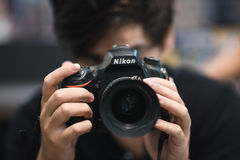 Nikon DSLR Photographer. Camera in hands stock photo