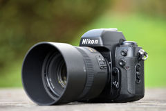 Nikon F-100 film camera body. Nikon F-100 film camera with Nikkor 85mm lens on May 8, 2017 in Vilnius, Lithuania. Nikon Corporation specializing in optics and stock photos
