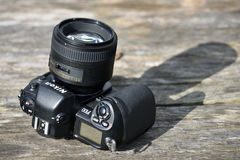 Nikon F-100 film camera body. Nikon F-100 film camera with Nikkor 85mm lens on May 8, 2017 in Vilnius, Lithuania. Nikon Corporation specializing in optics and royalty free stock photography