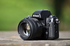 Nikon F-100 film camera. With Nikkor 85mm lens on May 8, 2017 in Vilnius, Lithuania. Nikon Corporation specializing in optics and imaging products Stock Photos