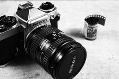 Nikon FE camera. Black and white image of Nikon FE analog camera and roll of film Stock Photos