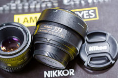 Nikon lens. Fix 35 mm. f1.8 put on nikon book Stock Photography