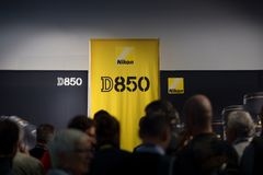 Nikon Live in Milan present new D850. MILAN, ITALY - SEPTEMBER 16 2017: Nikon Live in Milan present new D850, people in  queue to try the new reflex Royalty Free Stock Photos