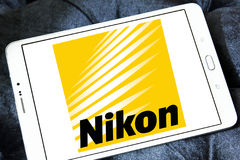 Nikon logo. Logo of camera manufacturer nikon on samsung tablet Royalty Free Stock Photo