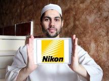 Nikon logo. Logo of camera manufacturer nikon on samsung tablet holded by arab muslim man Royalty Free Stock Photography