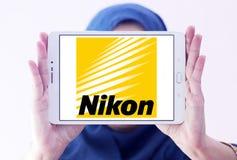 Nikon logo. Logo of camera manufacturer nikon on samsung tablet holded by arab muslim woman stock image