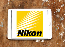 Nikon logo. Logo of camera manufacturer nikon on samsung tablet on wooden background royalty free stock image
