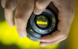 Nikon logo. Viewed through a lens Stock Photos