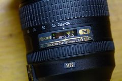 Nikon 24-120mm AF-S lens at the shop. Saigon, Vietnam - Jan 2, 2017. Close-up of Nikon 24-120mm AF-S lens at the shop in Saigon, Vietnam Stock Photography
