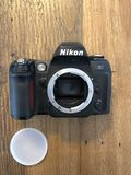 Nikon. A Nikon camera dslr and slr film and digital n60 vintage on a wood background stock photography