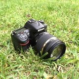 Nikon photocamera on grass. The best Nikon photocamera on grass Stock Photography