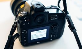 Nikon Professional DSLR camera update firmware Royalty Free Stock Photo