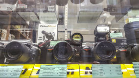 Nikon Store. An Italian Nikon store, Nital. Different kinds of digital reflex DSRL camera with mounted on lenses on display at a local Italian nikon store with Stock Photo