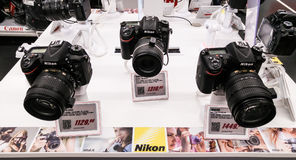 Nikon Store. An Italian Nikon store, Nital. Different kinds of digital reflex DSRL camera with mounted on lenses on display at a local Italian nikon store with Royalty Free Stock Image