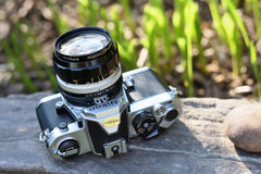Nikon vintage film camera. With Nikkor 35mm lens on May 8, 2017 in Vilnius, Lithuania. Nikon Corporation specializing in optics and imaging products Royalty Free Stock Images