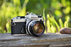 Nikon vintage film camera. With Nikkor 35mm lens on May 8, 2017 in Vilnius, Lithuania. Nikon Corporation specializing in optics and imaging products Stock Photography
