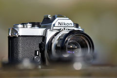 Nikon vintage film camera. With Nikkor 35mm lens on May 8, 2017 in Vilnius, Lithuania. Nikon Corporation specializing in optics and imaging products Stock Photos