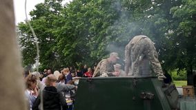 NIKOPOL, UKRAINE - MAY, 9, 2019: Ukrainian military cooks soldiers` porridge and treats people to it at the parade in honor of Vic. Ukrainian military cooks stock video footage