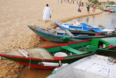 Nile. Excursion boats at the banks of Nile in Aswan, Egypt.A souvenir seller goes to the tourists. Foto was taken in april 2007 Stock Photography