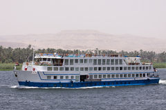 Nile cruise. A boat in the waters of the nile while cruising Royalty Free Stock Images