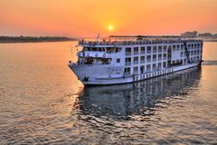 Nile cruise. Cruiser boat on the Nile River at sunset, Egypt (HDR photo royalty free stock photos