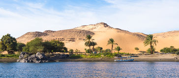 Nile. Egypt. Sunset, Sand dunes on the Coastline of the Nile river part called First Cataract, Aswan, Egypt stock image