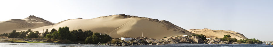 Nile River ,Aswan. Panoramic of the the sun setting on the West banks of the Nile River stock photo