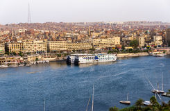 Nile River by Aswan City skyline with Boats Stock Images