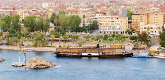 Nile River by Aswan City skyline with Boats. ASWAN, EGYPT - APRIL 26, 2014: Aswan city skyline with Nile river and Boats on April 26, 2014 in Aswan, Egypt Royalty Free Stock Photography