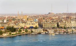 Nile River by Aswan City skyline with Boats. ASWAN, EGYPT - APRIL 26, 2014: Aswan city skyline with Nile river and Boats on April 26, 2014 in Aswan, Egypt Stock Photos