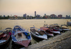 Nile river with boats in cairo egypt. Nile river with boats at sunset in cairo egypt Stock Image
