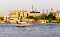 Nile River commercial life by Aswan City with Boats. ASWAN, EGYPT - APRIL 26, 2014: Aswan by the Nile river with commercial life and boats on April 26, 2014 in Royalty Free Stock Images