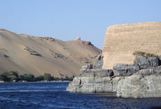 Nile river, Egypt. Scenic view of the Nile river with old and historic building on riverbank, Egypt near Aswan Stock Images