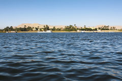 Nile river landscape. With mountains and palm trees Royalty Free Stock Photo