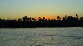 Nile River på solnedgången Fotografering för Bildbyråer