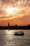 Nile Sunset. A Nile felucca and boat at sunset stock images