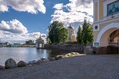 Nilov Monastery on the Stolobny island, Tver region. In front of the main entrance through the Svetlitskaya gate tower. Royalty Free Stock Photo