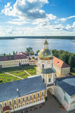Nilov Monastery. View from the bell tower in the direction of the gate Church of the St. Apostles Peter and Paul. Tver region. Royalty Free Stock Photo