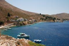 Nimborios, Symi island. Boats moored near Nimborios beach on the Greek island of Symi Royalty Free Stock Images