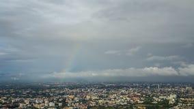 Nimbus and rainbow over the city stock footage