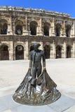 Nimeño II statue and Roman Amphitheater in Nimes Stock Photo
