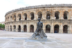 Nimeño II statue in front of Nîmes arena in France Stock Photo