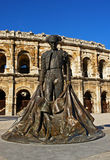Nimes bullring and statue Stock Photo