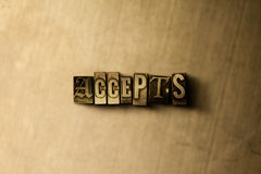 NIMMT - Nahaufnahme des grungy Weinlese gesetzten Wortes auf Metallhintergrund an Stockbilder