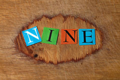 Nine. Text on a wooden board royalty free stock photos