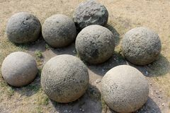 Ancient cannonballs on the ground stock images