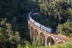 Nine Arches Bridge and blue train in Sri Lanka, Ella. Royalty Free Stock Image