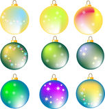 Nine assorted colorful christmas balls on white Royalty Free Stock Photography